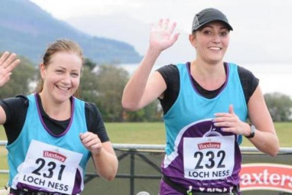 Jennifer and Lynsey running and waving during the Loch Ness marathon