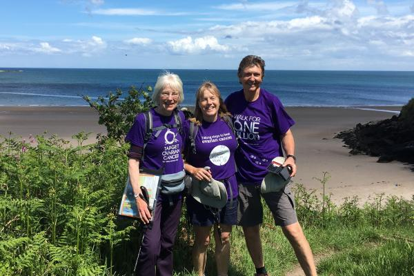 Three Target Ovarian Fundriasers walking along a sunny coastal path