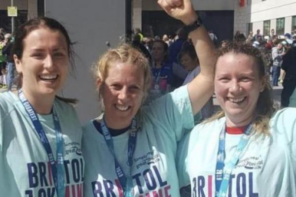 Jo Edwards and two other runners with their medals after finishing the Bristol 10K