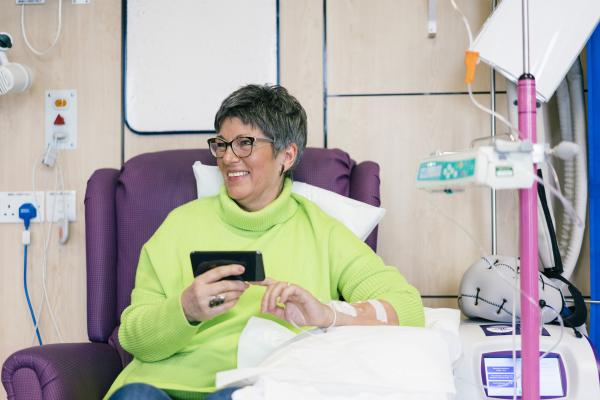 woman on phone having chemo