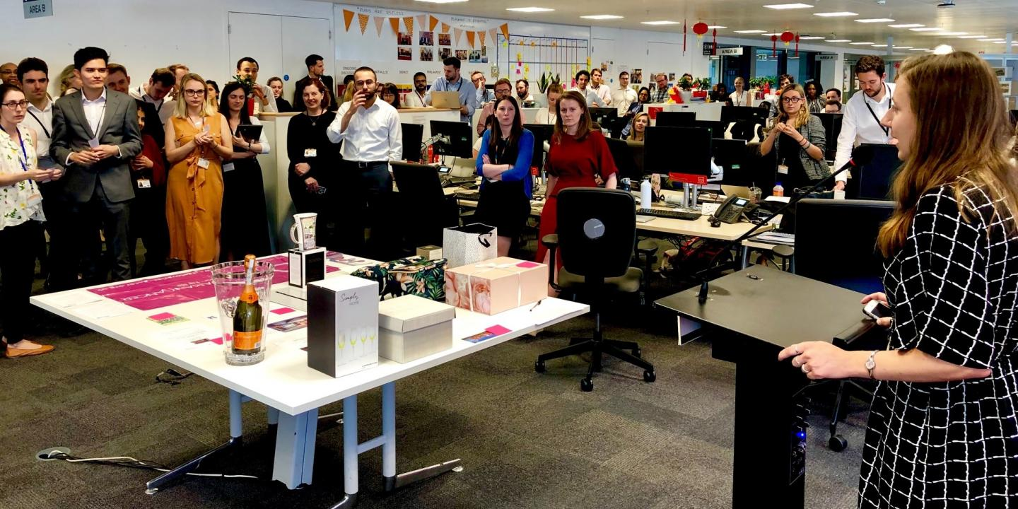 A raffle tacking place in a large office with lots of people in aid of Target Ovarian Cancer