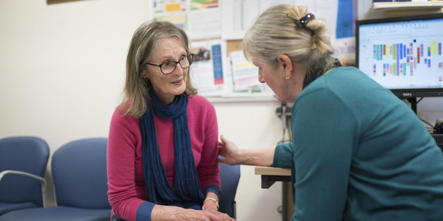 A woman is comforted by a GP in the GP's office