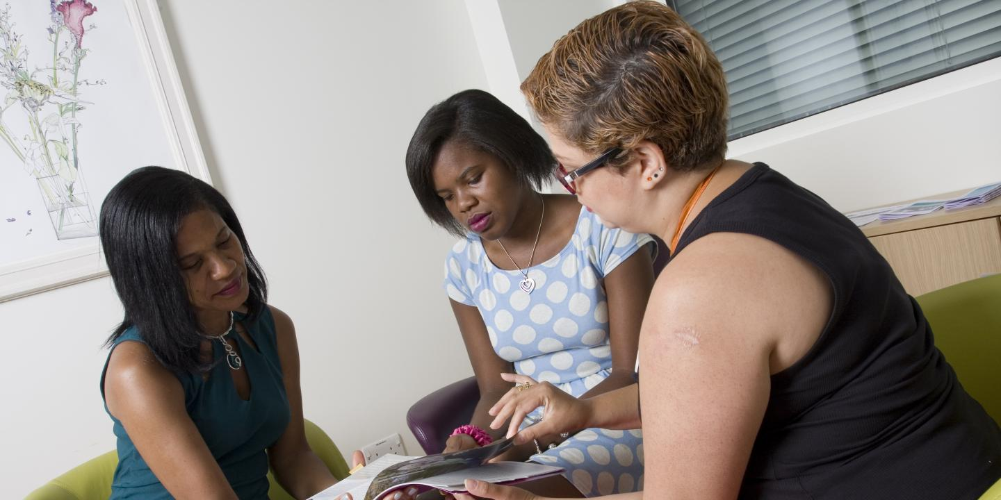 Women sat down discussing information about ovarian cancer