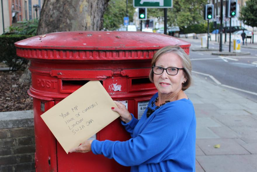 A Target Ovarian Cancer campaigner posting a letter to their local representative
