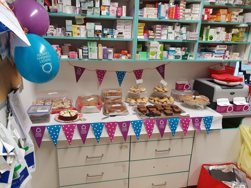 A bake sale for Target Ovarian Cancer held in a healthcare professional's office