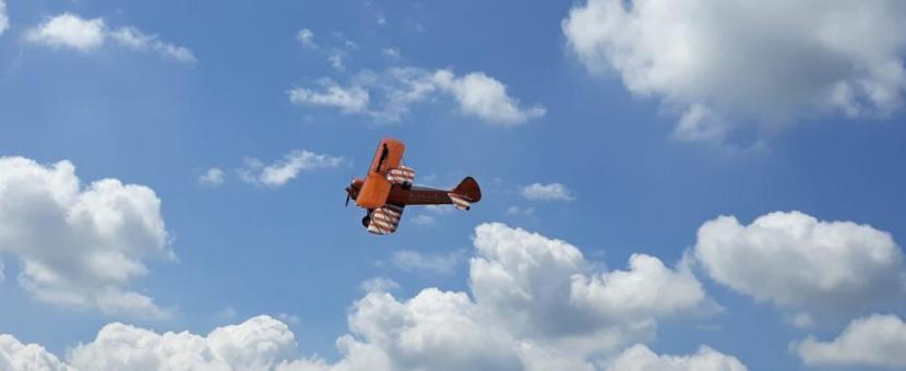 A biplane flying in the sky