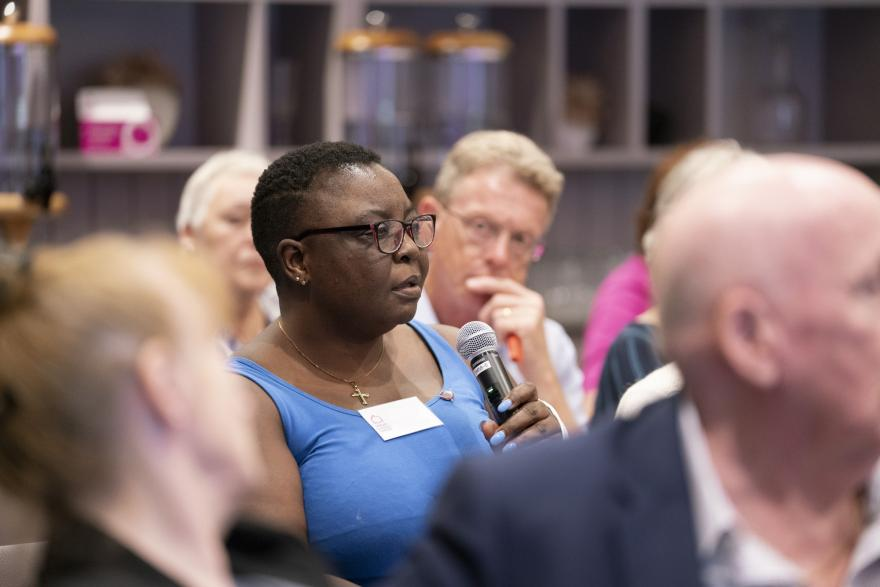 A woman asking a question at a Target Ovarian Cancer Ask the Experts event