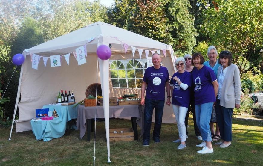 Family and friends enjoying a raffle in a garden while raising money Target Ovarian Cancer