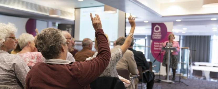 Participants raising their hands at a Target Ovarian Cancer Ask the Experts event