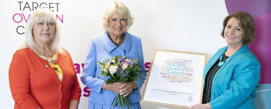 Rona Passmore and Target Ovarian Cancer Chief Executive Annwen Jones presenting HRH The Duchess of Cornwall with a framed commermorative collaborative message of words that describe Target Ovarian Cancer