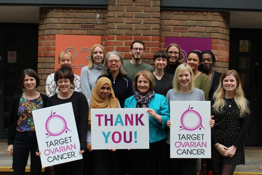 Target Ovarian Cancer staff team holding thank you signs