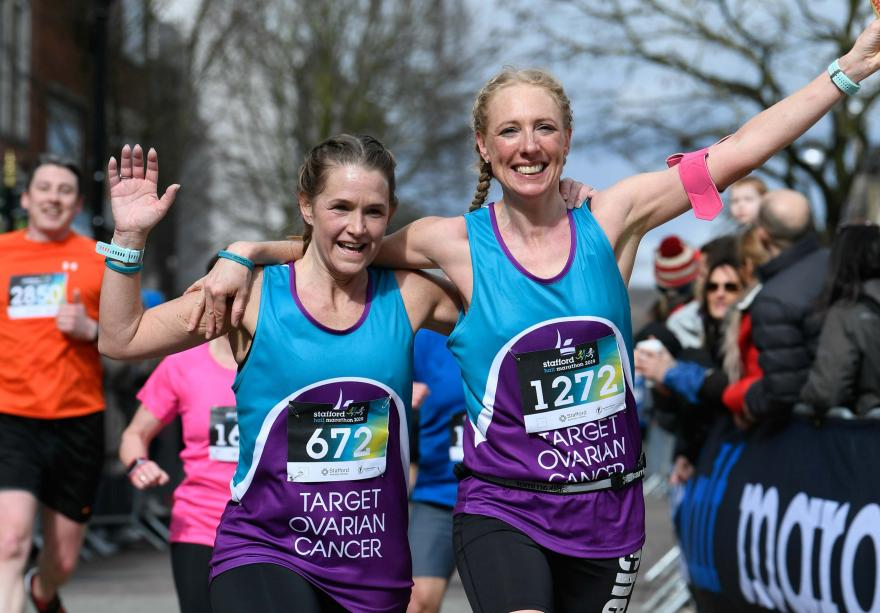 Two Target Ovarian Cancer fundraisers running and waving