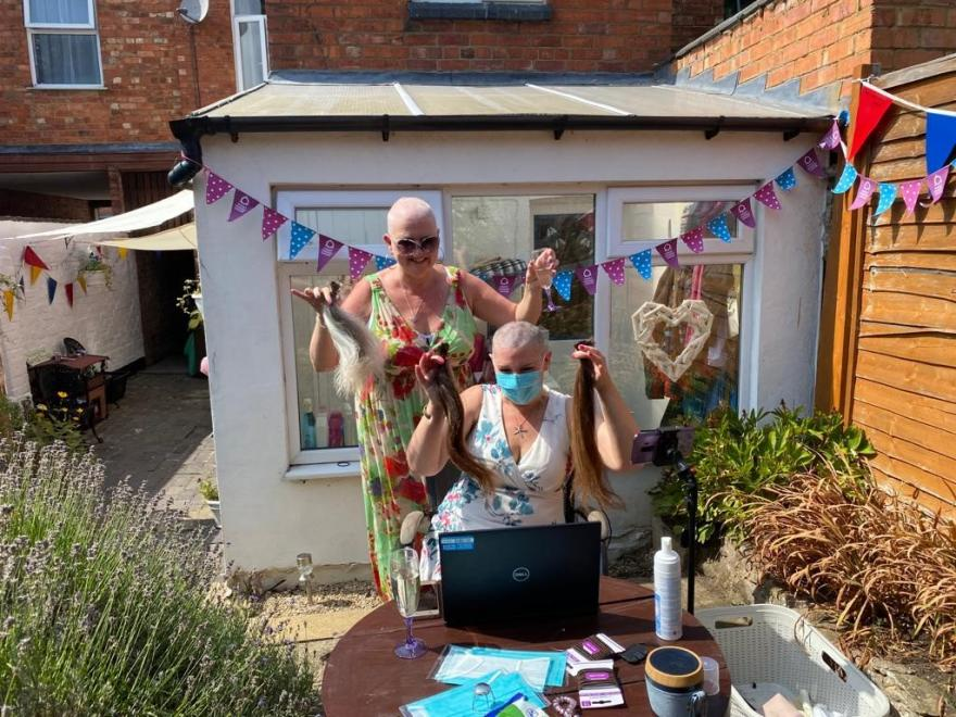 Two Target Ovarian Cancer fundraisers completing a headshave for Target Ovarian Cancer